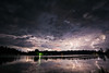Bolts Beyond the Bay (Matt Molloy) Tags: mattmolloy timelapse photography photostack night sky storm clouds lightning bolts light water lake bay reflection grass trees littlecranberrylake haskinspoint seeleysbay ontario canada nature landscape lovelife