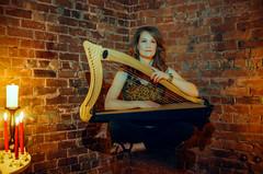 Floating with Her Harp (djking) Tags: woman canada brick calgary levitation redhead alberta candel talitha
