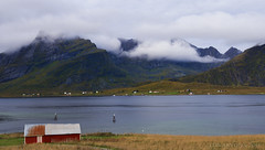 a Norwegian barn with a view (lunaryuna) Tags: panorama seascape mountains fall norway architecture clouds barn landscape islands seasons peaks lunaryuna lofoten lowclouds lofotenislands northernnorway seastrait norwegiansea lofotenwall lofotenarchipelago autumnabovethearcticcircle shroudedinclouds theimportanceofredinnorway
