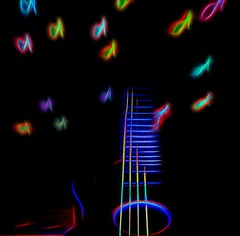 Music Sets The Soul Free (Phyllis74) Tags: music lensbaby glow notes guitar topaz