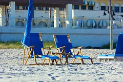 Beach seating:  Thank you for 18,006,695 views!!! (LarryJay99 ) Tags: chairs seats blue sand sandy beach outdoors re seashore blues urban lakeworthbeachlakeworth florida lines fenceverticals rails levelsbrickwall sunshine shadows beachfurniture umbrellas