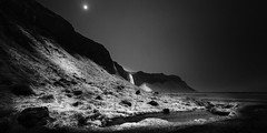 Moon Over Seljalandsfoss (Mabry Campbell) Tags: 2013 april europe houstonphotographer iceland mabrycampbell scandinavia seljalandsfoss southiceland southerniceland architecturalphotography architecturephotography blackandwhite bw cliffs collectingpool commercialphotography dark editorialphotography fineartphotographer fineartphotography ice image landscape monochrome moody moon photo photograph photographer photography rocks snow water waterfall f71 april132013 201304130h6a0458edit 17mm ⅕sec 100 ef1740mmf4lusm
