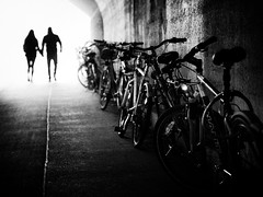 hand in hand (Sandy...J) Tags: silhouette urban blackwhite bicycle monochrom blurred people light underpass tunnel walking darkness atmosphere