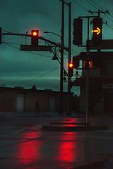 Red Light (Jonathan Kos-Read) Tags: oakland lonely rain reflections fruitvalestation twilight redlight dusk lonliness 135mm