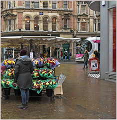 Flowers in the rain (geoff7918) Tags: corporationstreet newstreet flowerseller 10 wolverhampton