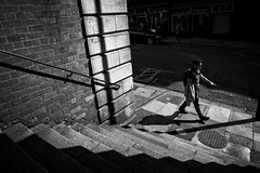 Newcastle - Striding confidently into the future (Pat Kelleher) Tags: light shadow white black texture blancoynegro stone candid streetphotography cobble shade enblancoynegro patkelleher patkelleherphotography