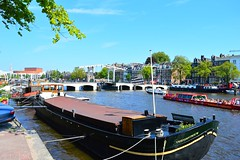 """Amsterdam (View of the Magere Brug """"Skinny Bridge"""" & the Amstel River) (Netty 78) Tags: city bridge blue trees sky urban holland green water netherlands amsterdam clouds buildings river skinny boats europe european cityscape union capital north nederland brug amstel the benelux 2015 magere of"""