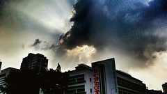 (jumppoint5) Tags: city light urban building clouds shadows rays threat