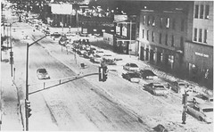 Cars try to navigate snow-clogged streets in Denver. (Rocky Mountain News / Denver Public Library Archives)