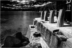 Pier at Northcote Auckland (elpedro1960) Tags: pier auckland northcote nz newzealand sea seas foreshore wharf monochrome concrete weathered water rock blackandwhite bw