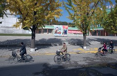 Kaesong street scene (Frühtau) Tags: корея северная dprk north korea street scene people kaesong bycicle fahrrad propaganda poster slogan students country nordkorea passers by construction architecture architektur building strasse korean war rebuild east asia asian culture leute daily life centre zentrum 朝鲜 朝鮮 cháoxiān 地 province gebäude gebäudekomplex outdoor