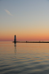 Frankfort Harbor Sunset (Katie Weyant) Tags: light sunset usa lighthouse color nature water colors america canon rebel michigan frankfurt pastel greatlakes amateur greatlake t6s