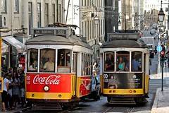 LISBON - A COUPLE OF STREETCARS (Punxsutawneyphil) Tags: city red urban rot portugal beautiful yellow vintage europa europe traffic lisboa lisbon oldschool retro gelb stadt 28 cocacola lissabon baixa streetcar verkehr southerneurope streetcars sdeuropa strasenbahn strasenbahnen