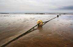 Somos levedad (RalRuiz) Tags: espaa gris mar andaluca huelva playa cielo nubes boya olas atlntico alga ocano islacristina playacentral