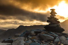 Man Made Mountain (creativegaz) Tags: shadow silhouette shapes sky sunset sun rays rock pile stone rocks nikon shadows snowdon nature outdoors walk wales