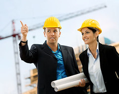 Real Estate Developers (eugenebernshtam) Tags: architect building worker helmet construction foreman engineer colleague industry builder expert skill engineering crane jib development designer professional plans pointing team teamwork manager happy smiling satisfied success successful career consultant contractor architecture people business workplace urban working occupation employment male female man woman blueprint suit shirt blue collar 3035years 30s structure site hungary
