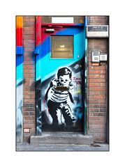 Street Art (Unknown), East London, England. (Joseph O'Malley64) Tags: unknown streetart urbanart graffiti eastlondon eastend london england uk britain british greatbritain art artist artistry artwork stencilwork stencil boy polaroidcamera door doorway firedoor woodendoor entrance exit wirereinforcedglass hydraulicdoorclosure rollershutterframe brickwork bricksmortar pointing entrysystem keypadentry bell intercom signplate concretestep wiring pavement urban urbanlandscape aerosol cans spray paint fujix accuracyprecision