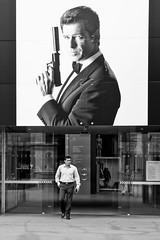 Melbourne 07 (Peter.Bartlett) Tags: victoria olympusomdem5 unitedkingdom australia city doorway walking door urbanarte peterbartlett man urban streetphotography candid uk m43 microfourthirds sign bw poster macphuntonality blackandwhite lunaphoto people jamesbond 007 melbournemuseum