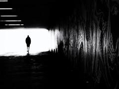 the stranger (Sandy...J) Tags: olympus tunnel darkness light grafitti blackwhite monochrom man walking wall streetphotography urban