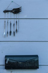 """blue monday (listening to """"girl from the north country"""", johnny cash and bob dylan) (jeneksmith) Tags: january blue metal forks windchime mailbox wall canon"""