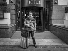 The Guest (Leanne Boulton) Tags: monochrome urban street candid portrait portraiture streetphotography candidstreetphotography candidportrait streetportrait streetlife young man male face facial expression look emotion feeling posture standing travel travelling hotel guest lobby tone texture detail natural outdoor light shade naturallight city scene human life living humanity people society culture canon 5d 5dmarkiii 28mm character wideangle ef2470mmf28liiusm black white blackwhite bw mono blackandwhite glasgow scotland uk