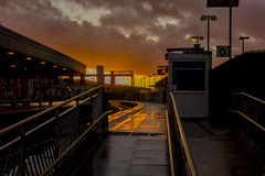 Empty platform at sunset: Cardiff Central station (Dai Lygad) Tags: sunset sun light clouds cardiffcentral station platform empty reflections evening march sunday weekend closed customerinformation quiet flickr canon camera 550d eos photos photographs pictures images photography wales uk stormy rails railways railroads tracks amateurphotography jeremysegrott dailygad caerdydd cymru caerdyddcanolog britain british