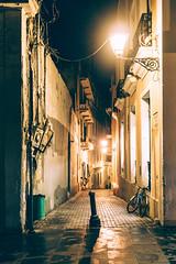 Running Late (fllad.shehu) Tags: urban wet rain night puerto island lights lowlight oldsanjuan puertorico rico sanjuan pr dim oldstreet crooked