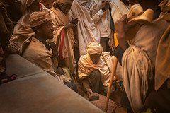 Why lift a rock? (departing(YYZ)) Tags: africa travel people outside religious group ceremony christian holy ritual tradition ethiopia pilgrim lalibela easternorthodox eastafrica ethiopianorthodox sonnartfe35mmf28za