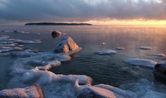 When the Light Gets Golden (tinamar789) Tags: golden light winter ice snow sunset sun sea seashore seascape rocks horizon cold frost freezing mist lauttasaari helsinki finland