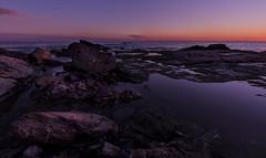 The last rays of sun (Christian Ferrari) Tags: sun sunset sky clouds rays sea seascape light rocks water beach wave