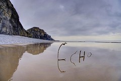 Echoes of the lonely (pauldunn52) Tags: driftwood traeth mawr glamorgan heritage coast wales beach art environmental wet sand cliffs reflections