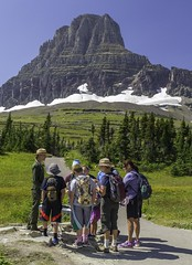 Ranger and Visitors at Glacier National Park (Patrick Gregerson) Tags: august glaciernationalpark montana experience landscape mountains nationalparkservice people summer sunny travel water work outside outdoors ranger visitors snow trail trees trip children kids parents hiking inspiration inspiring sky clearskies