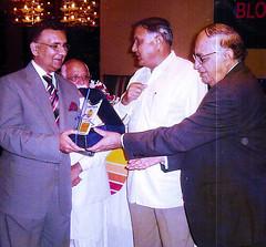 Receiving a shield from Senior Minister Sardar Ahmed (Doc Kazi) Tags: pakistan public health dr ghulam nabi kazi