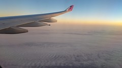 High above the pacific (kev10212) Tags: sky scenic sunset planes trip flying tail airplanes clouds dusk altitudes