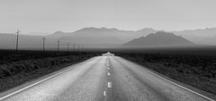 Death Valley Road (Rik Tiggelhoven Travel Photography) Tags: death valley national park np nps service centennial california usa america amerika panorama serene black white blackandwhite bw bn canon 6d ef24105mmf4lisusm nature outdoor landscape landschaft landschap landskap paysage paisagem paisaia paisaje paisaxe rik tiggelhoven travel photography monochrome road mountains layers scenic byway desert powerlines power lines leadinglines leading fog sw