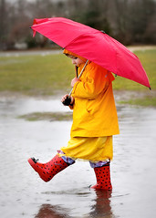 puddle jumper (queen's lace) Tags: red rain yellow umbrella children interestingness photographer 25 cape cod i500 pleaseaddyourwinningphototothegrouppool tc49rain abigfave top20yellow capecodphotographer thebestyellow