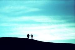Hilltop Dreams (slightly-less-random) Tags: seattle silhouette xpro couple crossprocess roadtrip holdinghands hilltop trashcam cameraakira