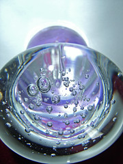 trapped bubbles (bubblynadine) Tags: light glass tag3 taggedout ball globe tag2 tag1 object bubbles 2006 refraction paperweight kiss2 kiss3 kiss1 kiss4 bubblynadine