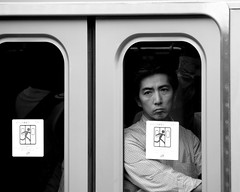 The face behind the doors (manganite) Tags: windows portrait people men topf25 face station japan tag3 taggedout digital train asian japanese tokyo nikon asia doors tl candid trains full d200 dslr yamanote crowded yamanoteline july1 18200mmf3556 manganite nikonstunninggallery 25faves challengeyou july12006 angkorsingle challengeyouwinner date:year=2006 date:month=july