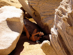 reader digested (isl_gr (Mnesterophonia)) Tags: reading sandstone rocks mediterranean ikaria aegean may greece heat hiker noon   mavri kavopapas geniiloci trailofthelighthouseguards