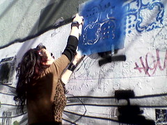 Glenda spraying stencil @Mary street (Glenda GlitaGrrl) Tags: streetart art girl graffiti glasses stencil mural mosaic sydney leopard tiles newtown authorised glendapontes