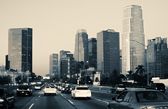 Downtown LA ('SeraphimC) Tags: road city sunset sky blackandwhite bw streets cars monochrome delete10 architecture scrapers canon buildings delete9 delete5 350d delete2 photo losangeles highway downtown driving skyscrapers traffic delete6 delete7 28mm north 110 save3 delete8 delete3 delete delete4 save save2 save4 freeway duotone save5 autos roads rebelxt asphalt showing automobiles challengeyouwinner