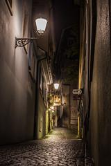 Damp Alley (gseglenieks) Tags: night dark switzerland zurich alley urban light lights rain damp wet old historic europe european cobblestone