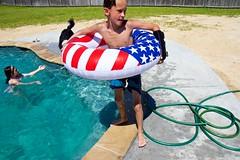 (heatherbirdtx) Tags: boy summer dog sunlight water pool composition swimming swim fence daylight kid backyard arm outdoor candid hose brace innertube starsandstripes