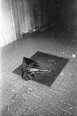 Broken Umbrella (christait) Tags: street canada calgary broken umbrella downtown grain sidewalk alberta yyc ilforddelta3200 yycstreet