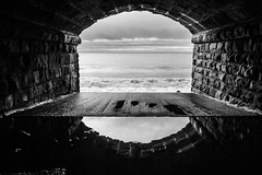 Looking out to sea mono (alf.branch) Tags: sea blackandwhite bw seascape reflection water mono seaside waves railway tunnel olympus zuiko parton irishsea refelections seawaves partonbeach olympusomdem1 zuiko1240mmf28pro