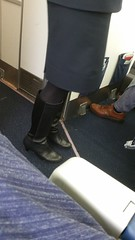 20161208_092359 (ph4eveh) Tags: candid flight attendant black boots tights secy legs woman