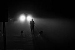 The dog walker incident (SebRiv) Tags: biddefordpool foggynight maine truck manwalkingtwodogs street photo following mystery silhouette shadow lights mysterious intriguing noiretblanc black white blackandwhite shadows dog walker
