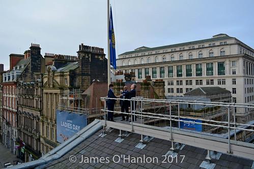 Chief Angus, Gary Millar and Lord Mayor raising flag