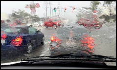 Downpour at Tustin and Katella (greenthumb_38) Tags: rain screencapture downpour iphone jeffreybass itneverrainsinsocalifornia